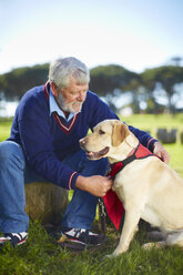 Senior man with his dog - ZEF000995