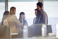 Businesspeople talking in boardroom - ZEF000282