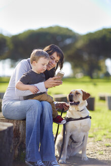 Mother and little son with dog - ZEF000872