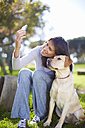 Woman taking a selfie with her dog - ZEF000865