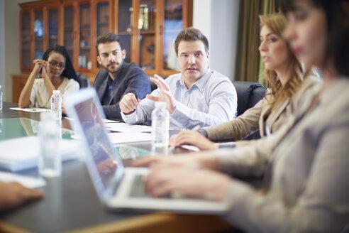 Businesswoman using laptop in boardroom - ZEF000294