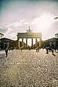 Germany, Berlin, Berlin-Mitte, Brandenburg Gate, Pariser Platz and tourists against the sun - KRPF001150