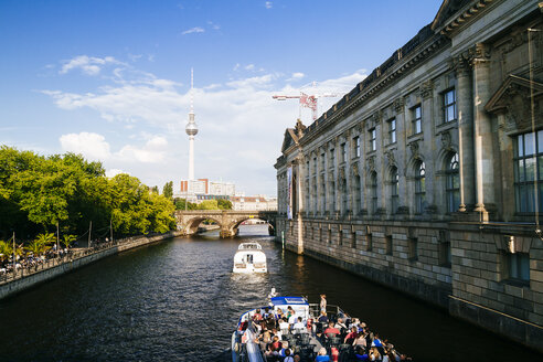 Germany, Berlin, view to television tower with tour boats on Spree River in the foreground - KRP001168