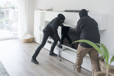 Two burglars at work in an one-family house at daytime - ONF000624