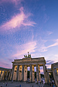Germany, Berlin, Pariser Platz, Brandenburger Gate at sunset - ZMF000348