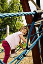 Little girl climbing on playground - LVF001884