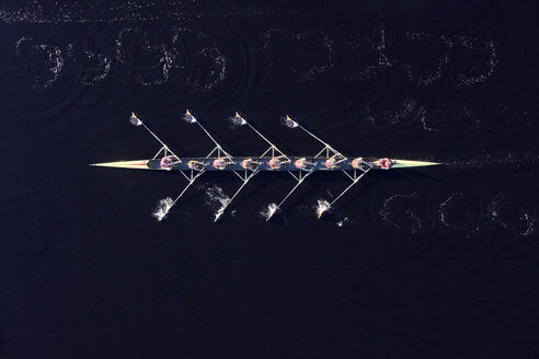 Elevated view of female's rowing eight in water - ZE000452