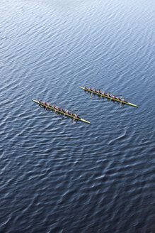 Elevated view of two rowing eights in water - ZEF000456