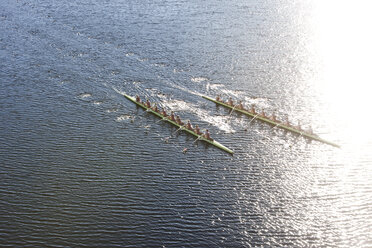 Elevated view of two rowing eights in water - ZEF000474