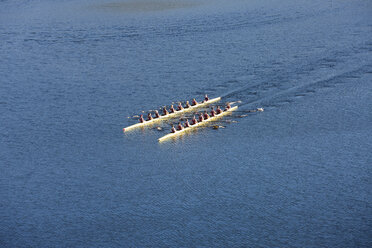 Elevated view of two rowing eights in water - ZEF000476