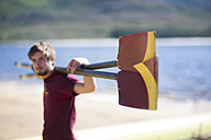 Rower holding oar at lakeshore - ZEF000465