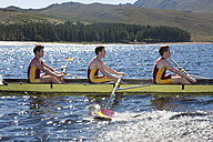 Men's rowing boat in water - ZEF000480