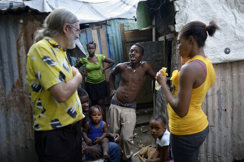 Haiti, Port-au-Prince, Icare Camp for earthquake refugees, Counselor talking to family - FLK000409