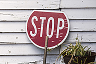 New Zealand, South Island, Ross, New Zealand, stop sign leaning at wooden facade - WV000717