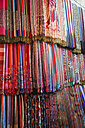 Morocco, Marrakesh, colorful fabrics on souk - RIM000303