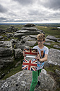UK, Cornwall, boy photographing himself  at Bodmin Moor with his digital tablet - PAF000960
