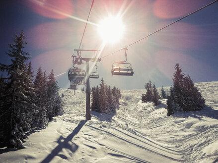 Austria, Salzburger Land, chair lift in winter landscape - NNF000030