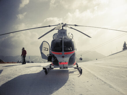 Austria, Salzburger Land, helicopter in winter landscape - NN000031