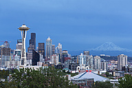 USA, Washington State, skyline of Seattle with Space Needle and Mount Rainier at blue hour - FOF007100