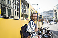 Germany, Berlin, Young man waiting for his girl friend - FKF000644