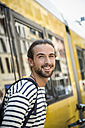 Germany, Berlin, Young man waiting for his girl friend - FKF000647