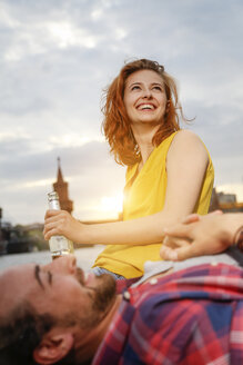 Germany, Berlin, Young couple enjoying sunset at Spree river - FKF000679