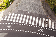 Germany, view to zebra crossing and bicycle lane from above - FMKYF000515