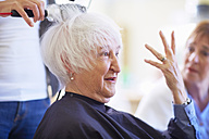 Portrait of senior woman in a hair salon - ZEF000978
