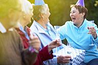 Senior friends on a birthday garden party - ZEF001032