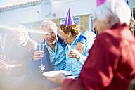 Senior friends on a birthday garden party - ZEF001038