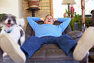 Man with dog relaxing at home - ZEF001079