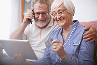 Senior couple shopping online at home - ZEF001091