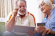 Senior couple shopping online at home - ZEF001093