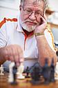 Senior man playing chess - ZEF001096