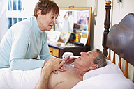 Senior woman caring for sick husband at home - ZEF001151