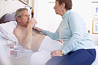 Senior woman caring for sick husband at home - ZEF001157