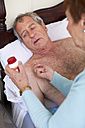 Senior woman caring for sick husband at home - ZEF001159