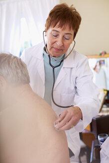 Doctor examining senior man at home - ZEF001160