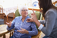 Medic caring for senior woman at home - ZEF001169