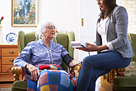 Medic caring for senior woman at home - ZEF001171