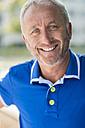 Portrait of smiling mature man wearing blue shirt - UUF002014