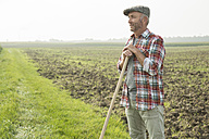 Farmer standing in front of a field - UUF002016