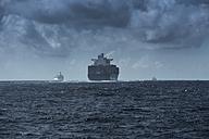 Spain, Andalusia, Tarifa, cargo ships on the ocean - KBF000180