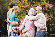 Extended family embracing in garden - WESTF020092