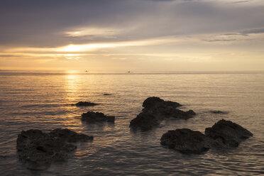 Slovenia, Istria, Slovene Littoral, Izola, Adriatic coast at sunset - WIF001106