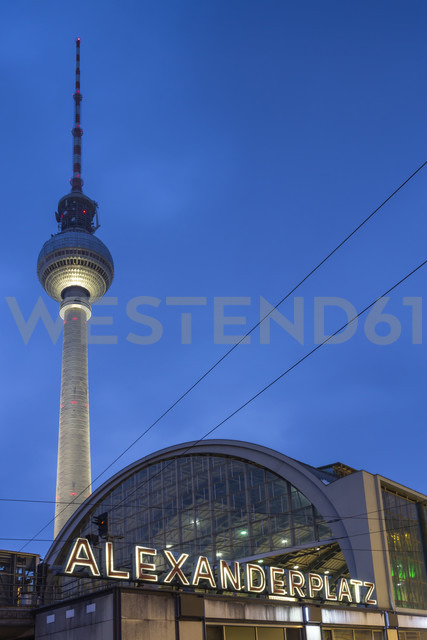 Germany, Berlin, view to television tower and train station at Alexanderplatz by twilight - NKF000190