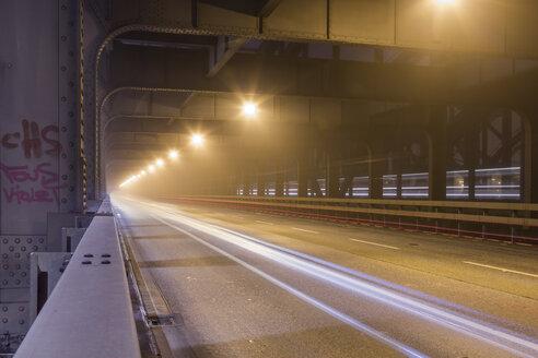 Germany, Hamburg, historic Elbe bridge in dense fog at night - NKF000193