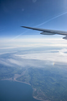 Left wing of a Boeing 777-200 above the Irish West Coast at sunrise - NKF000196