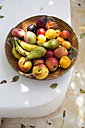 Spain, organic food, basket full of fruits - TKF000403