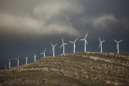 Spain, Andalusia, Tarifa, wind turbines on mountain - KBF000186